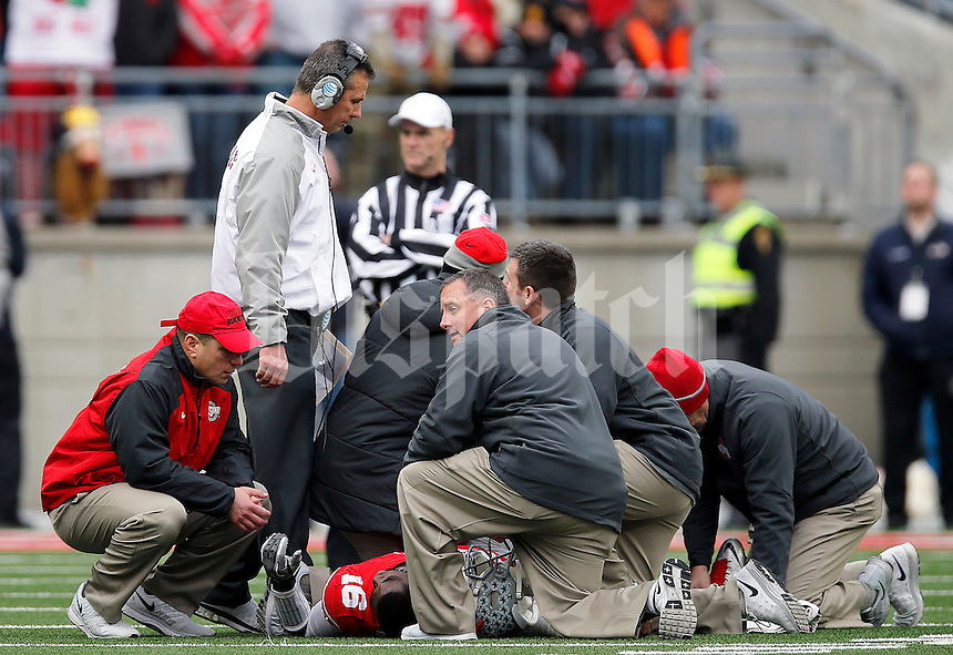 Ohio State Buckeyes head coach Urban Meyer looks at Ohio State Buckeyes quarterback J.T. Barrett's injury during the fourth quarter of the NCAA football game against Michigan at Ohio Stadium on Saturday, November 29, 2014. (Columbus Dispatch photo by Jonathan Quilter)