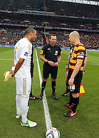 Pictured: Ashley Williams (L) and Gary Jones (R) with the referee Kevin Friend (C). Sunday 24 February 2013<br /> Re: Capital One Cup football final, Swansea v Bradford at the Wembley Stadium in London.