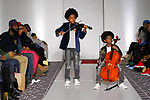 Young violinists perform on runway, for the 7th Golden Kids Runway fashion show at The Stewart Hotel in New York City, on March 11, 2018.