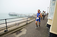 27 JUL 2013 - CROMER, GBR - Timothy Chapman  makes his way along the cliff top path near the pier during The Anglian Triathlon at Cromer, North Norfolk, Great Britain (PHOTO COPYRIGHT © 2013 NIGEL FARROW, ALL RIGHTS RESERVED)