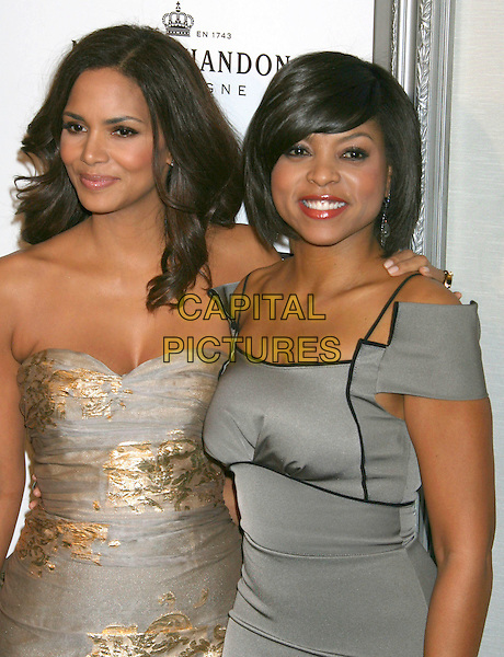 HALLE BERRY & TARAJI P. HENSON .Hosts the ESSENCE Black Women in Hollywood Luncheon held at The Beverly Hills Hotel, Beverly Hills, CA, USA, 19th February 2009..half length strapless gold silver patterned print metallic dress arm around shoulder .CAP/ADM/KB.©Kevan Brooks/Admedia/Capital PIctures