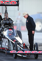 Jan. 19, 2012; Jupiter, FL, USA: NHRA top fuel dragster crew chief Richard Hogan (right) looks at driver Steve Torrence during testing at the PRO Winter Warmup at Palm Beach International Raceway. Mandatory Credit: Mark J. Rebilas-