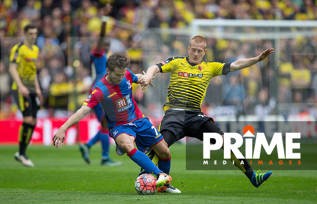 Yohan Cabaye of Crystal Palace turns Ben Watson of Watford during the FA Cup Semi Final match between Crystal Palace and Watford at Wembley Stadium, London, England on 24 April 2016. Photo by Andy Rowland.
