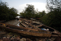small fishing boats stuck in the mud  in a poor neighborhood in  Bissau, Guinea Bissau on Saturday Sept 15 2007.///..Guinea Bissau is infamous for its cocaine trafficking. in 2005 Colombian cartels begun to arrive in the country transforming it into a Narco State. Up to 5 tons of pure cocaine are estimated to be arriving in the country every week. Guinea Bissau is the 5th poorest country in the world, making it the ideal transit base for the cocaine that will finish on the european markets. Corruption and involvement in the trafficking are present at every level of its institutions..Guinea Bissau is only one of the countries in West Africa involved in cocaine trafficking. Tons of Cocaine have been seized in Nigeria, Senegal, Ghana and  Sierra Leone.