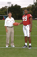 7 August 2006: Stanford Cardinal head coach Walt Harris and Levirt Griffin during Stanford Football's Team Photo Day at Stanford Football's Practice Field in Stanford, CA.