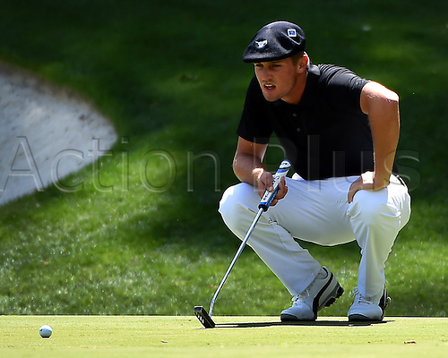 07.04.2016. Augusta, GA, USA. Bryson DeChambeau lines up a putt on the 13th green during the first round of the Masters Golf Tournament on Thursday, April 7, 2016, at Augusta National Golf Club in Augusta, Ga
