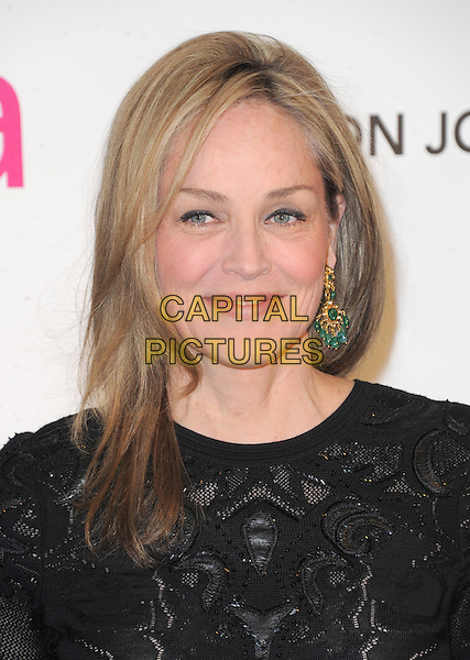 Sharon Stone.The 21st Annual Elton John AIDS Foundation Academy Awards Viewing Party held at The City of West Hollywood Park in West Hollywood, California, USA..February 24th, 2013.oscars headshot portrait lace dangling blue gold earring black.CAP/DVS.©DVS/Capital Pictures.