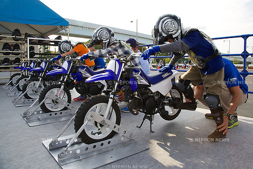 Children test Yamaha motorcycles during the Tokyo Motor Fes 2014 on October 11th in Odaiba, Tokyo, Japan. The Tokyo Motor Fes 2014 runs from October 11th to 13th with the aim of giving visitors of all ages a chance to interact with current and futuristic motorized vehicles. Held outside on reclaimed land in Tokyo Bay the event has enough space for visitors to test new vehicles and for a synchronized driving demonstration by the Cirque de Mobi. This year Mercedes-Benz and BMW will also participate along with 13 Japanese makers. (Photo by Rodrigo Reyes Marin/AFLO)