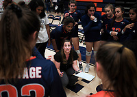 NWA Democrat-Gazette/CHARLIE KAIJO Rogers Heritage High School head coach Lindsey Biocic rallies her team during a volleyball game, Thursday, October 11, 2018 at Rogers Heritage High School in Rogers.