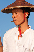 Myanmar, Burma.  Fisherman with Cheroot, Inle Lake, Shan State.