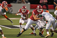 Hawgs Illustrated/BEN GOFF <br /> Ty Clary, Arkansas offensive lineman blocks Andrew Hines (9), Florida A&M freesafety, as Devwah Whaley (21), Arkansas running back, runs the ball in the first quarter Thursday, Aug. 31, 2017, during the game at War Memorial Stadium in Little Rock.