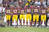 "Washington Redskins team president Bruce Allen, far left, locks arms in solidarity with players, from left to right, cornerback Kendall Fuller (29), long snapper Nick Sundberg (57), cornerback Fabian Moreau (31), nose tackle Ziggy Hood (90), defensive end Jonathan Allen (95), and outside linebacker Martrell Spaight (50) as the national anthem is sung prior to the game against the Oakland Raiders at FedEx Field in Landover, Maryland on Sunday, September 24, 2017. The Redskins chose to demonstrate prior to their nationally televised contest following tweets earlier in the day from United States President Donald J. Trump urging owners to ""fire or suspend"" players who participated in the protests by not standing for the anthem.<br /> Credit: Ron Sachs / CNP"