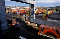 Shipping containers being loaded onto a cargo boat, Marseille, France.