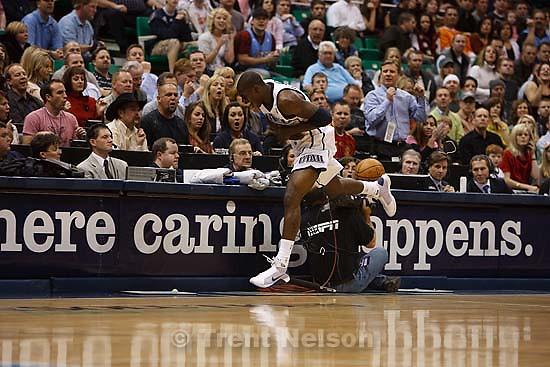 Salt Lake City - Utah Jazz vs. Toronto Raptors, NBA basketball Friday December 5, 2008. Utah Jazz guard Ronnie Brewer (9) collides with ESPN cameraman