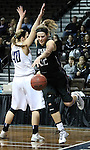 SIOUX FALLS, SD - MARCH 3:  Laura Johnson #32 from the University of Sioux Falls tries to drive baseline around  Anika Whiting #40 from Concordia St. Paul in the first half of their semifinal game of the NSIC Tournament Monday night at the Sanford Pentagon. (Photo by Dave Eggen/Inertia)