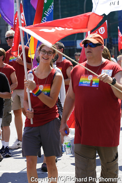 Participants walking in the Pride Parade in Montreal