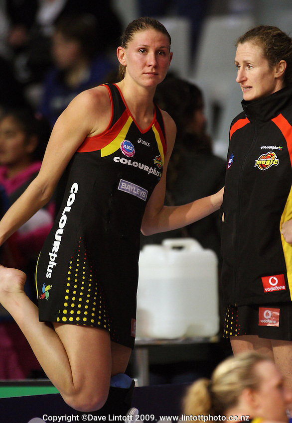 Casey Williams stretches next to Nicola Pettit after the loss during the ANZ Netball Championship match between the Waikato Bay of Plenty Magic and Adelaide Thunderbirds, Mystery Creek Events Centre, Hamilton, New Zealand on Sunday 19 July 2009. Photo: Dave Lintott / lintottphoto.co.nz