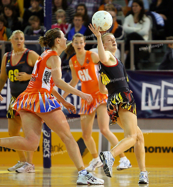 Commonwealth bank Trophy 29-7-07, Melbourne Kestrels v QLD Firebirds, Firebirds defeated Kestrels 61-54, Lauren Nourse juggles the ball in front of kestrels player Rebecca Bulley.  Photo: Grant Treeby