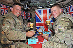 """**Strictly embargoed until 00:01 Sunday 3 June 2012**..QUEEN'S JUBILEE CELEBRATIONS.31/05/2012: Soldiers from the Kings Royal Hussars joined in the celebrations for the Queens Diamond Jubilee with a unique tea party of their own whilst serving in Helmand Province, Afghanistan..During a break from patrolling in their Mastiff armoured patrol vehicle Troopers Campbell and Cree made the time to break out some bunting sent from home by family and deck out their vehicle in the most patriotic of ways_02/06/2012.Picture Shows: (L-R) Trooper James Campbell 23, from Corsham, Wiltshire and Trooper Sam Cree 21, from Warrington of the King's Royal Hussars enjoy an impromptu Diamond Jubilee tea party..Mandatory Credit Photo: ©P Morrison/NEWSPIX INTERNATIONAL..**ALL FEES PAYABLE TO: """"NEWSPIX INTERNATIONAL""""**..IMMEDIATE CONFIRMATION OF USAGE REQUIRED:.Newspix International, 31 Chinnery Hill, Bishop's Stortford, ENGLAND CM23 3PS.Tel:+441279 324672  ; Fax: +441279656877.Mobile:  07775681153.e-mail: info@newspixinternational.co.uk"""
