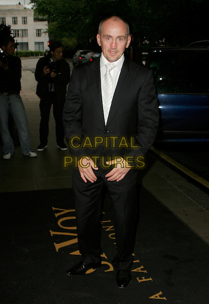 BARRY McGUISAN.Attending the RTS Television Sports Awards 2006,.The Savoy, The Strand, London, England,.May 29th 2007..full length black suit.CAP/AH.©Adam Houghton/Capital Pictures.