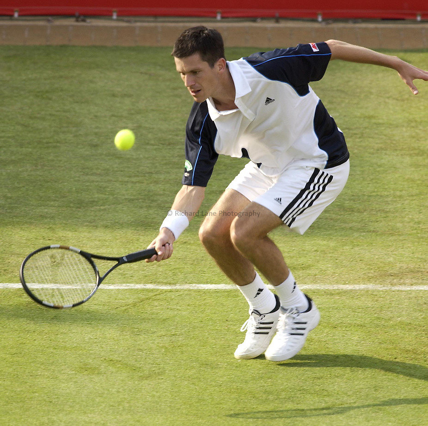 Photo. Daniel Hambury..The Stella Artois Championships..Queens Club, London..07/06/05..Tim Henman stretches to volley during his match against Robby Ginepri.