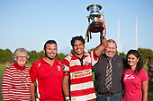 Victorious Karaka Captain Jamie Gilbert-Clark holds aloft the Trevor Wymer Memorial trophy that was being played for thre first time between the 2 clubs. With him are members of the Wymer family -Cathy Wymer, Paul, Wymer, Craig Wymer and Karen Hill. Counties Manukau Premier Club Rugby game between Patumahoe and Karaka, played at Patumahoe on Saturday 9th of April 2011..Karaka won 22 - 13 after leading 16 - 7 at halftime.