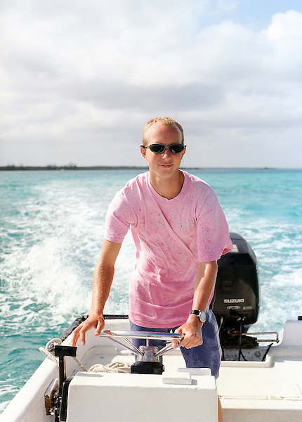 SOUTH ANDROS ISLAND, THE BAHAMAS : Tiamo resort's watersports director, Adam Mitchell, motor boats guests out to the popular snorkeling site known as The Crack. Tiamo is a Caribbean beach resort set in The Out Islands of The Bahamas. South Andros,The Bahamas.