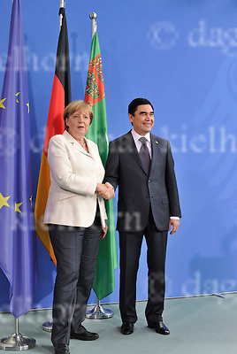 August 29-16,Chancellery,Berlin,Germany<br /> Turkmen President Gurbanguly Berdimukhamedov,r,after discussing selling gas to European Union countries, shake hands after a joint news conference with German Chancellor Angela Merkel.