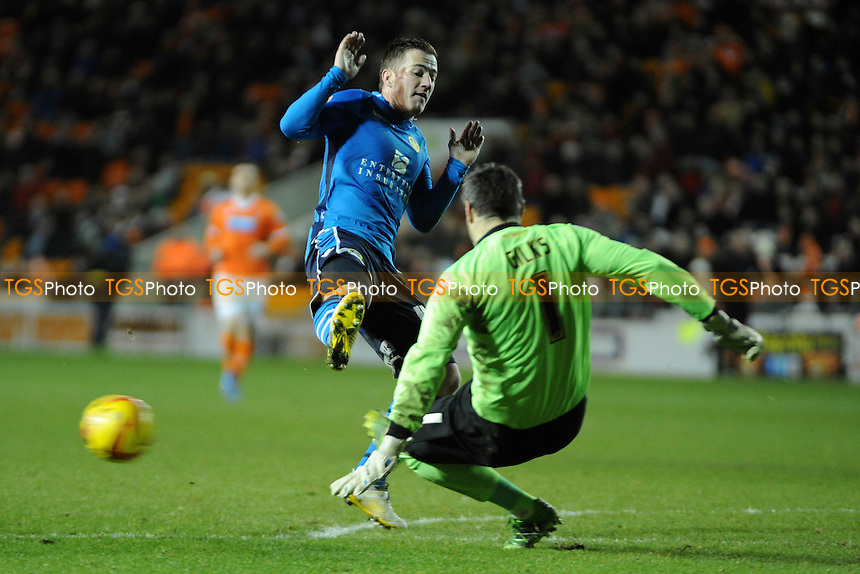 Matthew Gilks of Blackpool clears from Ross McCormack of Leeds United after a sloppy back pass  - Blackpool vs Leeds United - Sky Bet Championship Football at Bloomfield Road, Blackpool, Lancashire - 26/12/13 - MANDATORY CREDIT: Greig Bertram/TGSPHOTO - Self billing applies where appropriate - 0845 094 6026 - contact@tgsphoto.co.uk - NO UNPAID USE