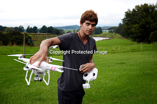 HOWICK, SOUTH AFRICA APRIL 5: Sixteen-year-old swimmer Michael Andrew handles his drone on April 5, 2015 in Howick, Natal, South Africa. Michael has broken many records already and he is seen as the new Michael Phelps. He turned pro at 14 after signing his first endorsement deal. Peter, his father trains Michael and he grew up in the US. His parents emigrated from South Africa and he spent some time in the country in April 2015 to visit his grandparents. (Photo by: Per-Anders Pettersson)