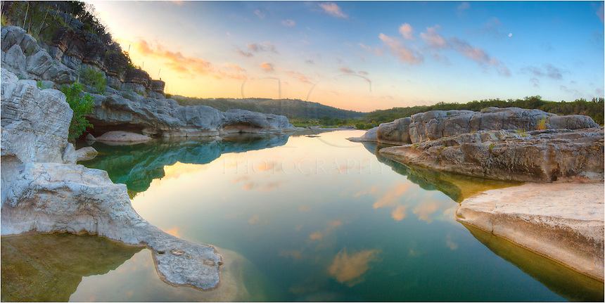 On a warm summer morning, the waters of the slow moving Pedernales River in Pedernales Falls State Park are still. This landscape is typical of the Texas Hill Country - rocks, trees, even a buzzard sitting on a rock. In these calm waters, native guadalupe bass sit and wait for their next meal and carp keep the river bottoms clean. This state park is one of my favorites to visit, and because of its proximity to my house, I'm able to make frequent visits out here for early mornings.