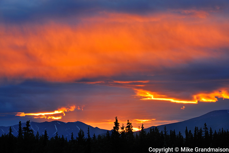 Clouds at sunset on the Alaska Highway<br /> near Whitehorse<br /> Yukon<br /> Canada