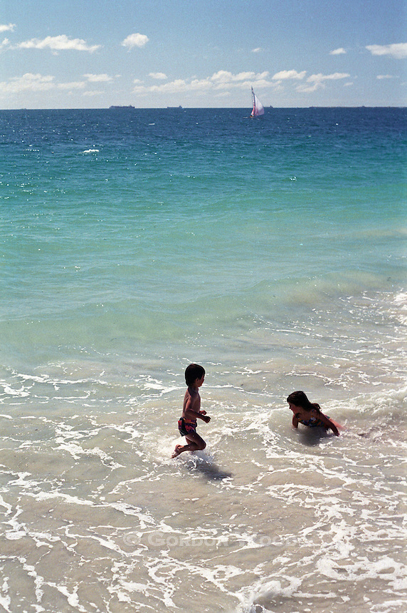Children Playing in Water on Beach in Western Australia