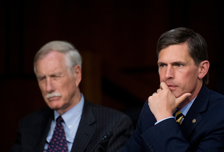 "UNITED STATES - JUNE 8: Sen. Martin Heinrich, D-N.M., right, and Sen. Angus King, I-Maine, listen as former FBI Director James Comey testifies during the Senate Select Intelligence Committee hearing on ""Russian Federation Efforts to Interfere in the 2016 U.S. Elections"" on Thursday, June 8, 2017. (Photo By Bill Clark/CQ Roll Call)"