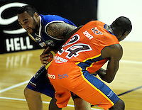 Saints forward Leon Henry and Sharks forward Sylvester Spicer wrestle for the ball. NBL - Wellington Saints v Southland Sharks at TSB Bank Arena, Wellington, New Zealand on Friday, 22 April 2011. Photo: Dave Lintott / lintottphoto.co.nz