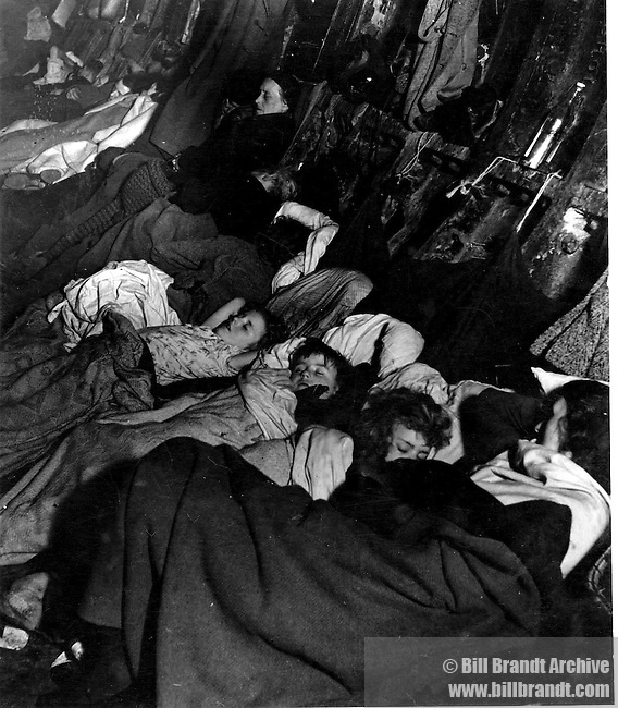 Crowded improvised air raid shelter in a Liverpool Street tube tunnel, 1940, Sept-Nov
