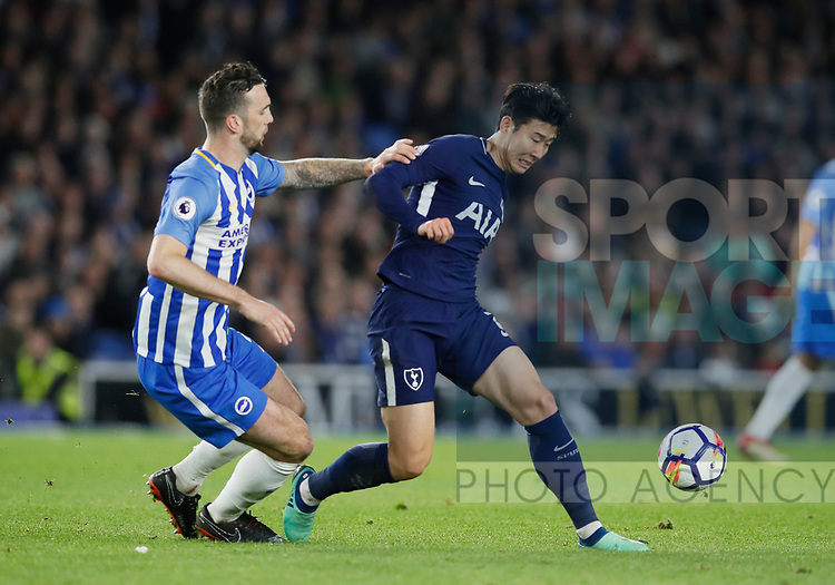 Son Heung-Min of Tottenham tackled by Shane Duffy of Brighton during the premier league match at the Amex Stadium, London. Picture date 17th April 2018. Picture credit should read: David Klein/Sportimage