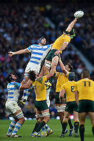 Scott Fardy of Australia wins the ball at a lineout. Rugby World Cup Semi Final between Argentina v Australia on October 25, 2015 at Twickenham Stadium in London, England. Photo by: Patrick Khachfe / Onside Images