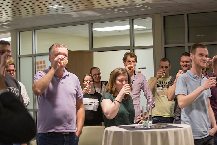 Participants in the training with Sogeti take a toast during the reception on March 10, 2016. Photo by Emily Matthews