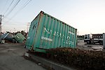 Mar. 13, 2011 - Ibaraki, Japan - Several freight containers are seen scatter all over the street in Oarai two days after the 8.9 magnitude earthquake struck followed by a tsunami that hit the north-eastern region. The death toll is currently unknown with casualties that may run well into the thousands.