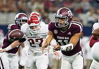 Hawgs Illustrated/Ben Goff<br /> Kellen Mond, Texas A&M quarterback, pitches the ball to a running back in the 1st quarter vs Arkansas Saturday, Sept. 29, 2018, during the Southwest Classic at AT&T Stadium in Arlington, Texas.
