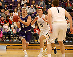 SIOUX FALLS, SD - DECEMBER 31: Aaron Rothermund #42 from the University of Sioux Falls drives to the basket past Adam Dykman #35 from Augustana University during their game Sunday afternoon December 31, 2017 at the Stewart Center in Sioux Falls, SD.  (Photo by Dave Eggen/Inertia)
