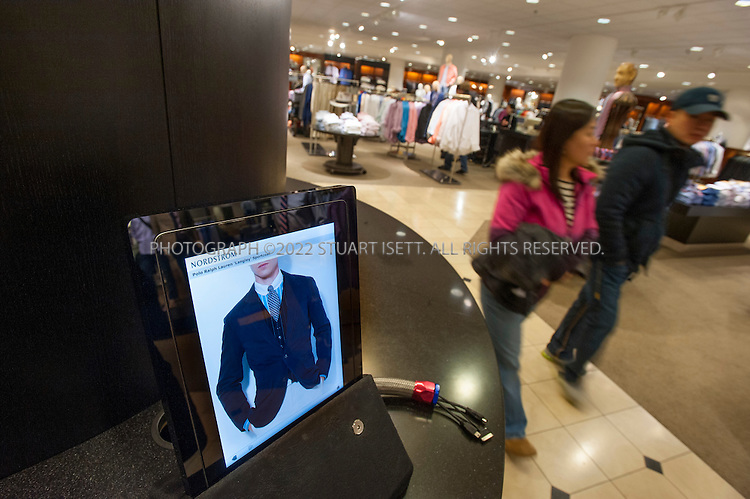3/1/2012--Seattle, WA, USA..In the men's department at Nordstrom in Seattle, WASH., an iPad is provided to customers to help them browse the store's website and catalog for items....©2012 Stuart Isett. All rights reserved.