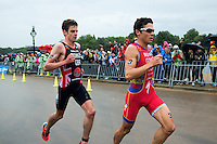 15 SEP 2013 - LONDON, GBR - Jonathan Brownlee (GBR) (left) of Great Britain follows Javier Gomez (ESP) (right) of Spain at the start of the second run lap at the elite men's ITU 2013 World Triathlon Series Grand Final in Hyde Park, London, Great Britain (PHOTO COPYRIGHT © 2013 NIGEL FARROW, ALL RIGHTS RESERVED)