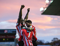 Lincoln City's Tom Pett, centre, celebrates scoring his side's second goal with team-mates John Akinde, left, and Bruno Andrade<br /> <br /> Photographer Chris Vaughan/CameraSport<br /> <br /> Emirates FA Cup First Round - Lincoln City v Northampton Town - Saturday 10th November 2018 - Sincil Bank - Lincoln<br />  <br /> World Copyright &copy; 2018 CameraSport. All rights reserved. 43 Linden Ave. Countesthorpe. Leicester. England. LE8 5PG - Tel: +44 (0) 116 277 4147 - admin@camerasport.com - www.camerasport.com
