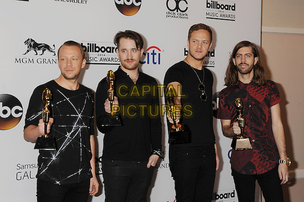 LAS VEGAS, CA- MAY 18: Musicians Ben McKee, Daniel Platzman, Wayne Sermon and Dan Reynolds of Imagine Dragons, winners of Top Rock Artist pose in the press room at the 2014 Billboard Music Awards at the MGM Grand Garden Arena on May 18, 2014 in Las Vegas, Nevada.<br /> CAP/ROT/TM<br /> &copy;Tony Michaels/Roth Stock/Capital Pictures