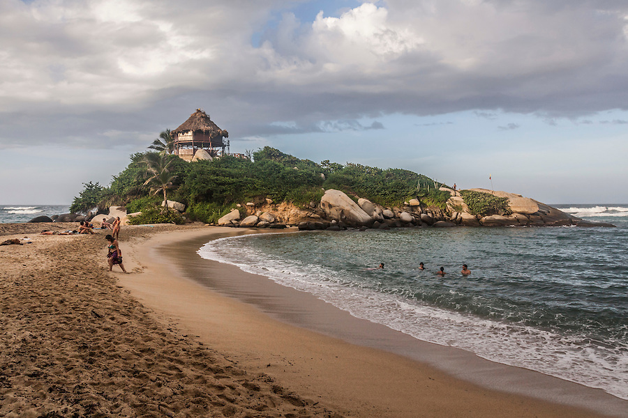 View of the beach and palapa where one can rent a hammock for the night at Cabo San Juan in Tayrona National Park near Santa Marta, Colombia.  The park is one of the most popular tourist destinations on Colombia's Caribbean coast.