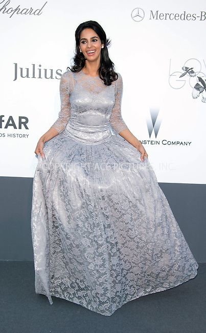 WWW.ACEPIXS.COM....US Sales Only....May 23 2013, New York City....Mallika Sherawat at amfAR's Cinema Against AIDS Gala at the Hotel du Cap Eden Roc during the Cannes Film Festival on May 23 2013 in France....By Line: Famous/ACE Pictures......ACE Pictures, Inc...tel: 646 769 0430..Email: info@acepixs.com..www.acepixs.com