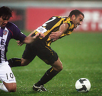 Phoenix' Manny Muscat is fouled by Wayne Srhoj during the A-League football match between Wellington Phoenix and Perth Glory at Westpac Stadium, Wellington, New Zealand on Sunday, 16 August 2009. Photo: Dave Lintott / lintottphoto.co.nz