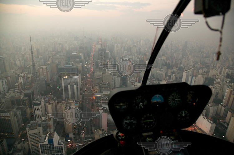Some top executives are avoiding moving around Sao Paulo overland, fearing mugging and even kidnapping..They estimate that the time they lose in traffic jams is more expensive than the costs of using or even owning a helicopter..